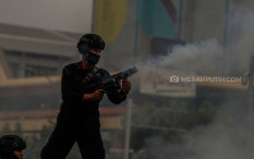 Ini Alasan Aparat Tak Boleh Pakai Senpi saat Demo Setahun Jokowi