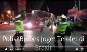 "Kena Demam ""Om Telolet Om"", Polisi Joget Saat Dengar Klakson Bus"