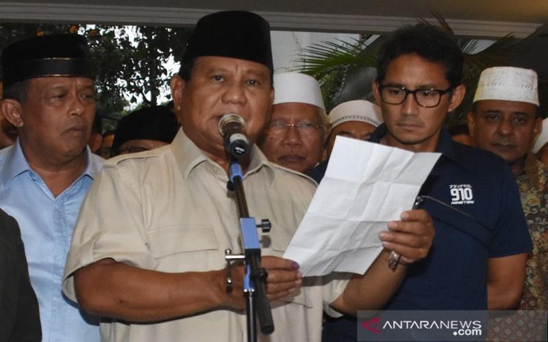 Beragam Tafsir Atas Ekspresi 'Cemberut' Sandi Saat Deklarasi 'Ronde 2' Kemenangan Prabowo