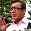 Lolosnya Djoko Tjandra dan Harun Masiku Jadi Alasan Kuat Jokowi Copot Yasonna