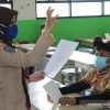 Sejumlah Guru Terpapar COVID-19 Saat Uji Coba PTM