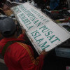 Polisi Bubarkan Relawan Korban Banjir Ber-atribut FPI di Cipinang Melayu