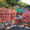 Jelang Imlek, Pedagang Mainan Miniatur Barongsai Asal Cirebon Mengadu Nasib di Solo